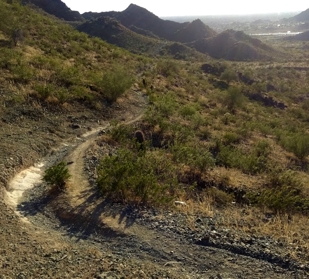 At the very top of a short, gnarly descent known to locals as the Chutes, located in the Phoenix Mountains Preserve. Because the original line is harder, a cheater line developed.